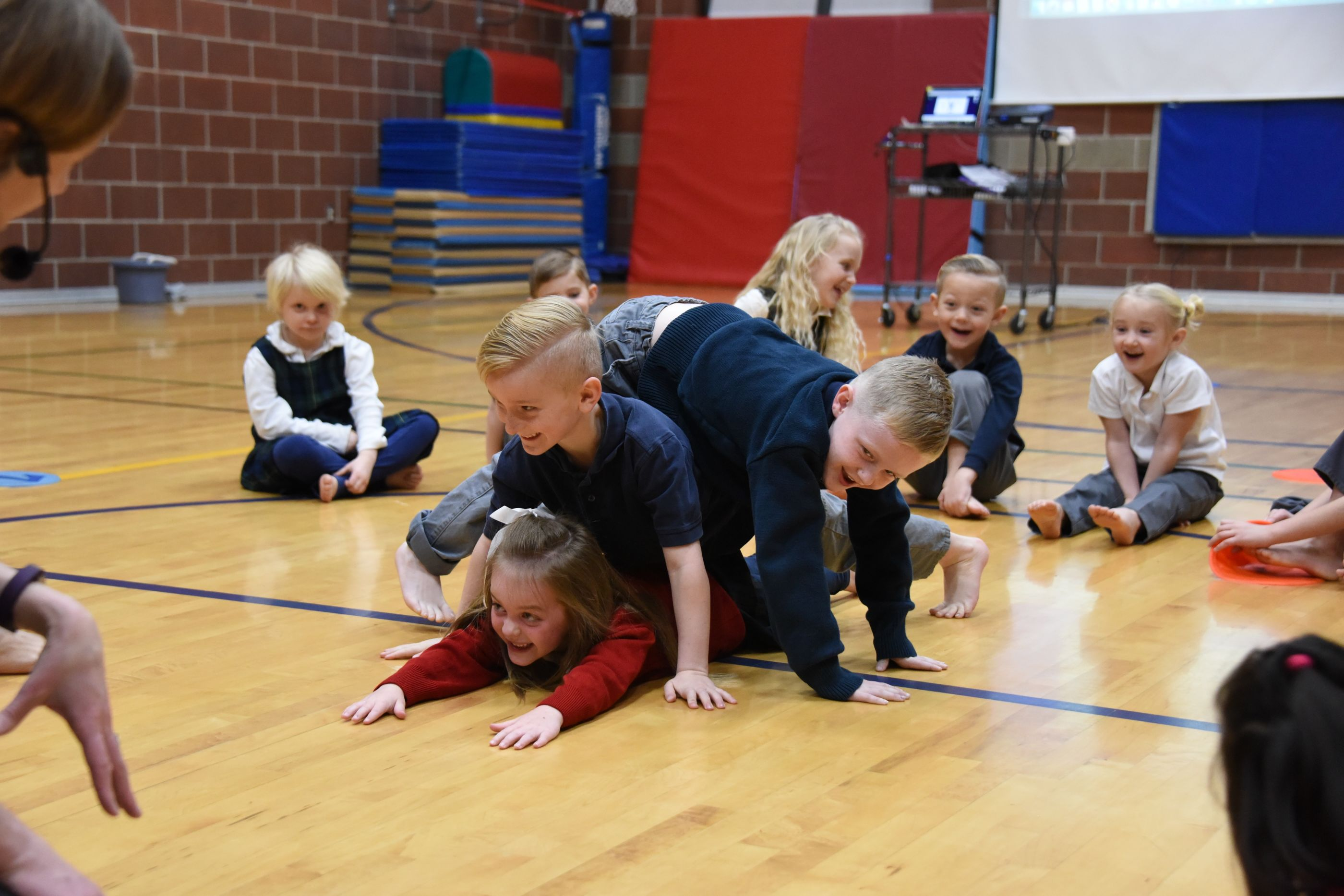 Students learn body awareness, balance and locomoter skills in dance.