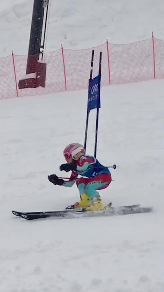 Ellie competes in the Park City Youth Ski League.