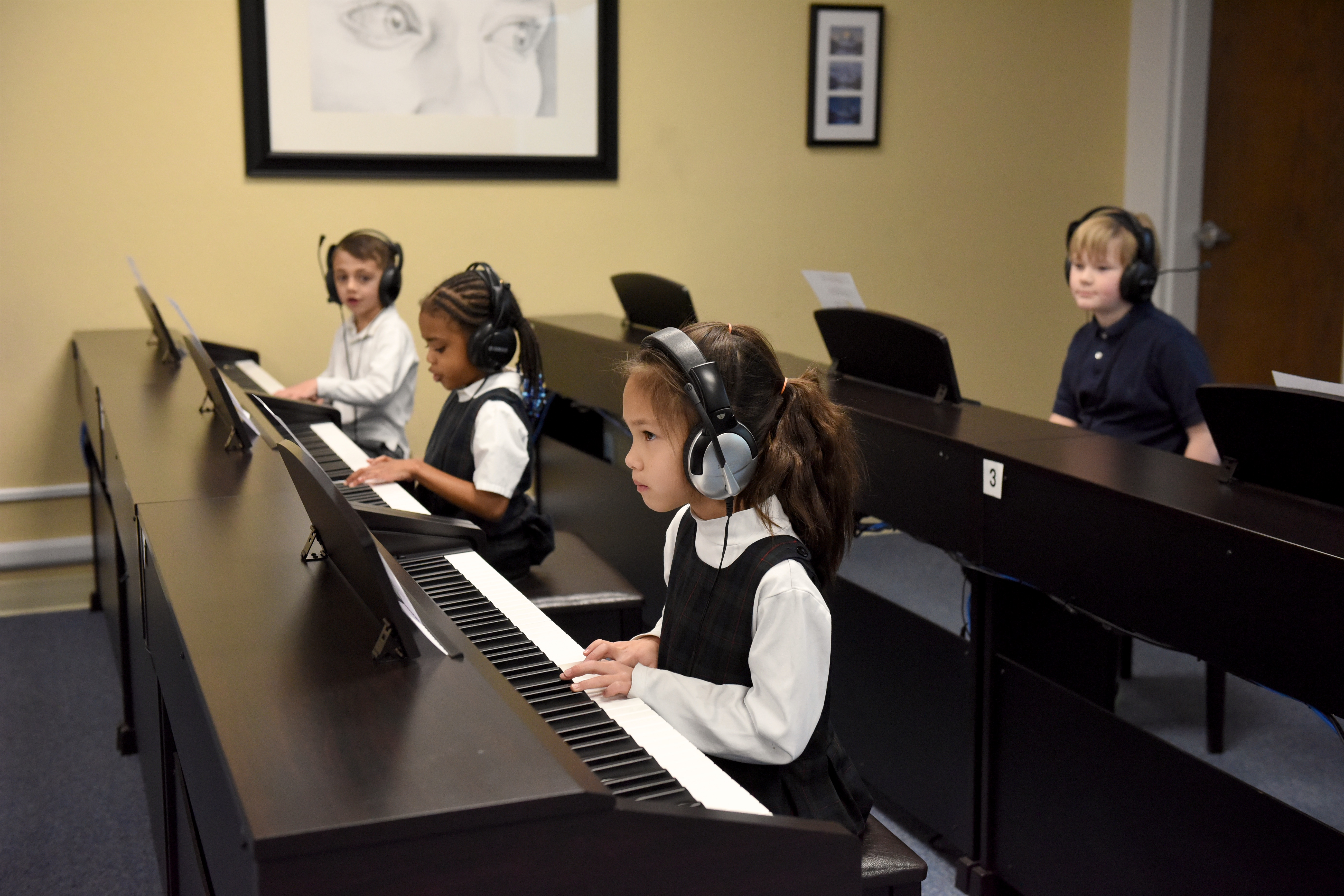 Students learn to read music on the piano with Waterford's music specialist.