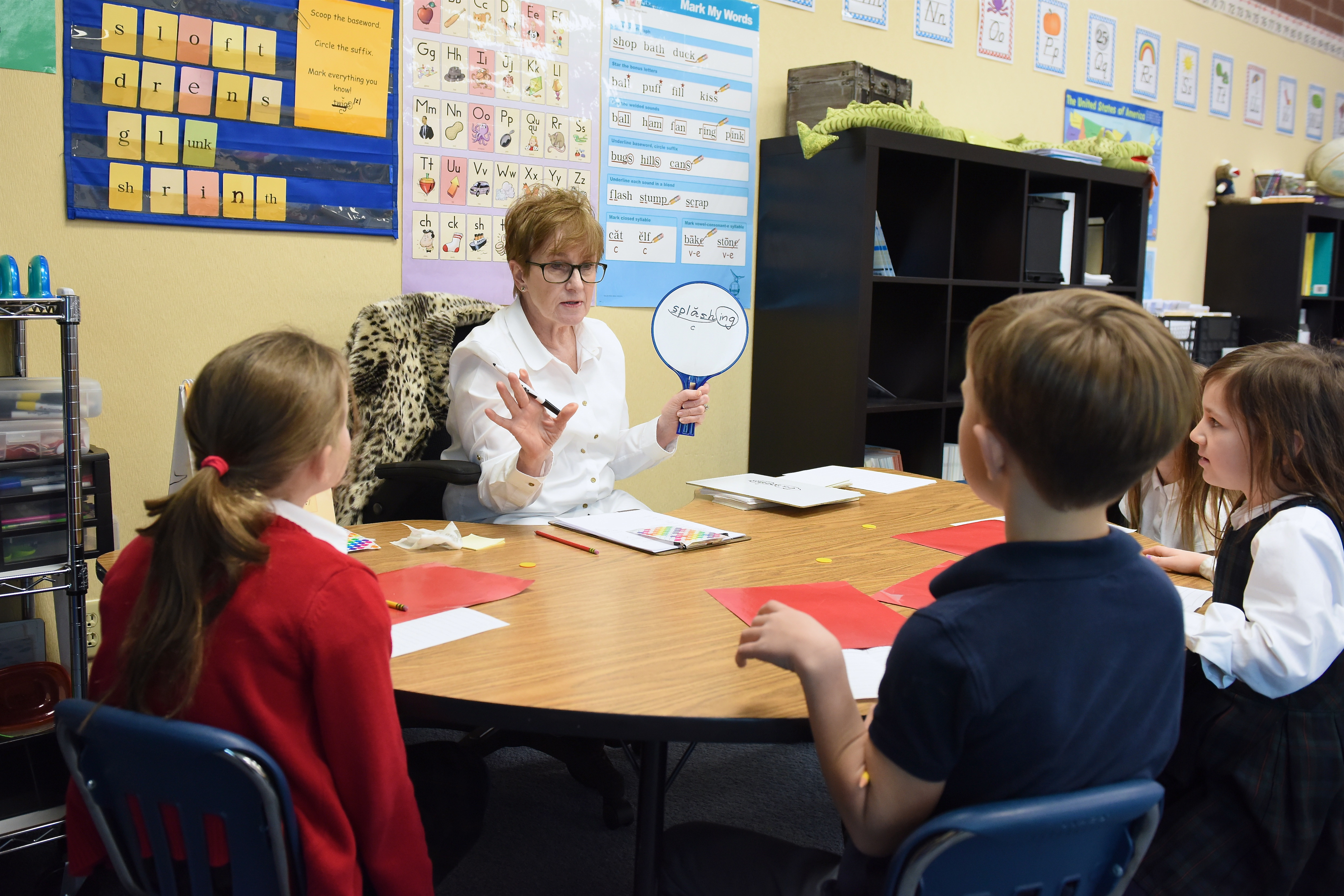 Melinda Zabriskie, Reading Assistant and Retired Waterford Class I Teacher, working with students on a Fundations unit.