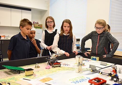Lower School robotics students preparing for the Animal Allies competition.