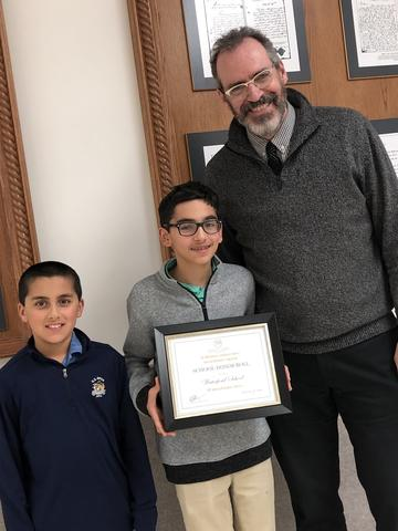 Liam R. '27  and Kiran R. '25 with Dr. Bennett