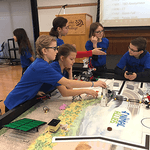Class V robotics teams competing at the First Lego League qualifier.