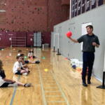 Tim Pettus teaches students about compromise in Waterford's physical education class