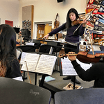 Kathy Morris works with students in Waterford's orchestra program.